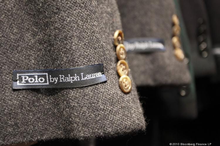 Branded labels sit on men's clothing at a Ralph Lauren store in London. The company's net income dropped 4 percent in the most recent quarter.