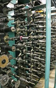 Some of the hundreds of tools each robotic machining center chooses among, in rapid succession, as it's milling a part.