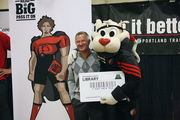 The Blazers' Read Big Campaign is a partnership with Portland-based Knowledge Universe, the largest private early childhood education provider in the U.S. The company is led by CEO Tom Wyatt, who posed with team mascot Blaze the Trail Cat on Tuesday.