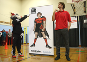 Lopez and Blaze unveil the superhero-esque character that, bearing a resemblance to Lopez, that will be featured in the Read Big campaign.