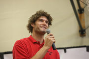 Lopez tells students of his love of reading, which included comic books.