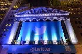 A banner with the Twitter Inc. logo hangs outside the New York Stock Exchange on Wednesday. Twitter Inc. raised $1.82 billion in its initial public offering.