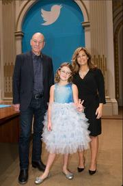 Twitter surprised Wall Street by sending three prominent users to ring the opening bell on the New York Stock Exchange on its first day of trading as a public company. They are (from left) actor Patrick Stewart, 9-year-old Vivienne Harr and a representative of the Boston Police.