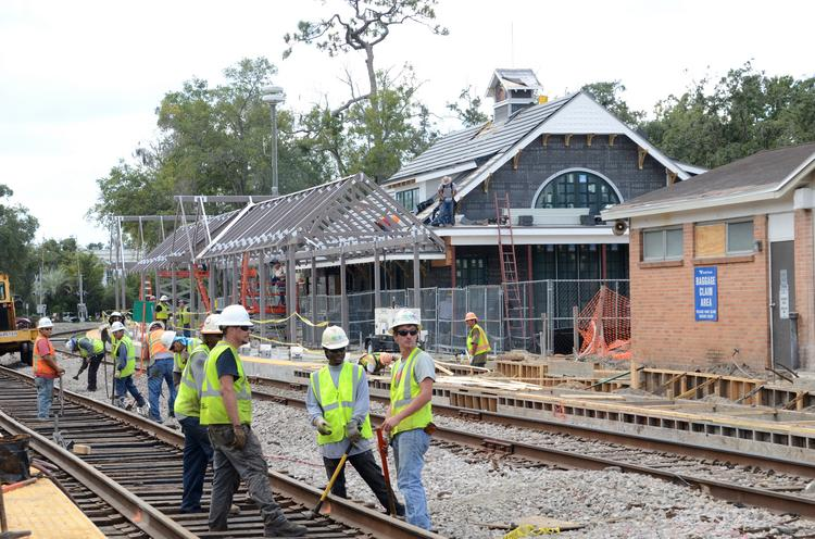 Construction crews make progress at the Winter Park train station with a looming December deadline.