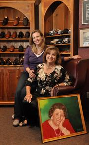 The Delmar Bootery owner Gail Leonardo Sundling and her daughter, Mandy Sundling Young. The painting is of Gail's mother, Jesse Leonardo, who started the business with her husband, a shoemaker, in 1938. Sundling Young will be the next generation to take over the business.