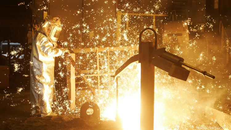 A worker taps a United States Steel Corp. blast furnace.