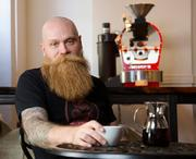 """Scott Carey put $250,000 and sweat equity into Sump Coffee, which roasts its own beans. """"If you don't put every ounce of what you do into every cup, there's no business,"""" he said."""
