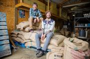 Goshen Coffee owner Jay Beard (left), with roaster Argus Keppel, said specialty coffee has boosted his $700,000-a-year business by 20 percent.