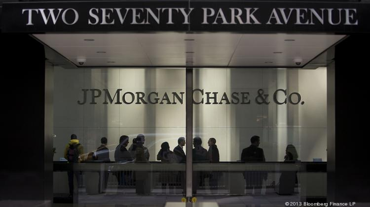 People stand in the lobby of JPMorgan Chase & Co. headquarters in New York.
