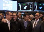 "Twitter's co-founders and CEO Dick Costolo were surrounded by press and onlookers on the floow of the New York Stock Exchange on the company's first day of trading. Shown, from left, are Jack Dorsey, ""Biz"" Stone, Evan Williams and Costolo."