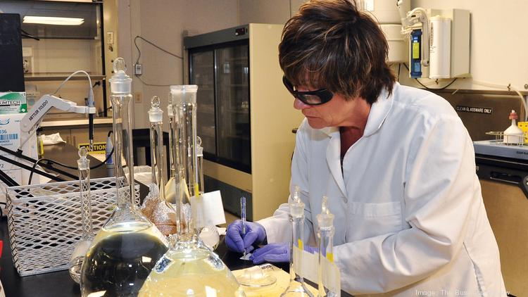 A Regeneron Pharmaceuticals quality control analyst works in the company's East Greenbush, New York test lab.