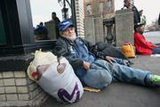 "John Lopez, originally from New York, waits outside the Portland Rescue Mission, which opened its 112-spot emergency shelter Nov. 1. Lopez said alcoholism led to homelessness but he was sober that day. ""No money."""