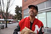 Johnny Nine Fingers said he lost his job — and right index finger — as a forklift operator and has been homeless for years. He was hoping to get a spot at the Portland Rescue Mission the day it opened, Nov. 1.
