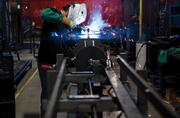 Aaron Elmore does welding work on a stretch-wrapping machine at Lantech Inc. Jim Lancaster, president of the company, says the BEAM initiative can go a long way to advance the skill set of Kentucky workers.