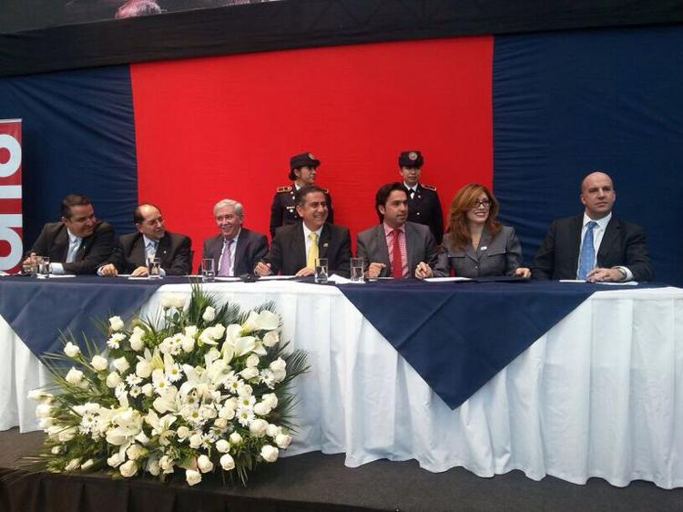 """Chicago Department of Aviation Commissioner Rosemarie Andolino  (second from right) appeared  in Quito, Ecuador Wednesday to  sign a """"Sister Airport"""" agreement.  Note the lush fresh floral arrangement adorning the stage."""