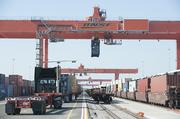 Giant cranes at Logistics Park Kansas City move containers between rail and trucks.