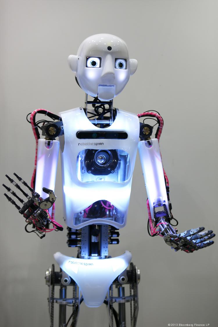 The RoboThespian interactive humanoid robot, developed by Engineered Arts Ltd., stands on display.
