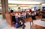 Here's a family enjoying lunch at a food court. The question is: Are they buying back-to-school fashions or on their way to the Delta gate?