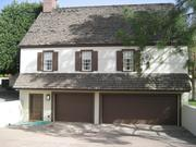 The property features a guesthouse with a three-car garage.