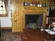 The farmhouse's three fireplaces are built in the style of the colonial era.