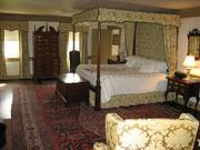 The bedrooms of the manor include colonial inspired bedding.
