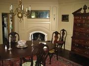 The dining room of Nordon Manor includes a chandelier and fireplace.