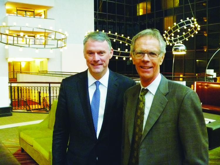 Warren Beck, at right, and Paul Wischermann, whose firm will run the Sheraton Bloomington.