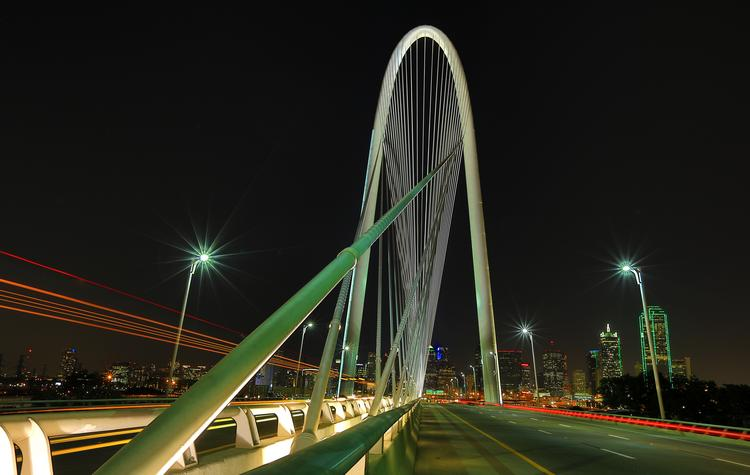 The Margaret Hunt Hill Bridge, designed by noted architect Santiago Calatrava, is one of the newest artful enhancements to the Dallas skyline.