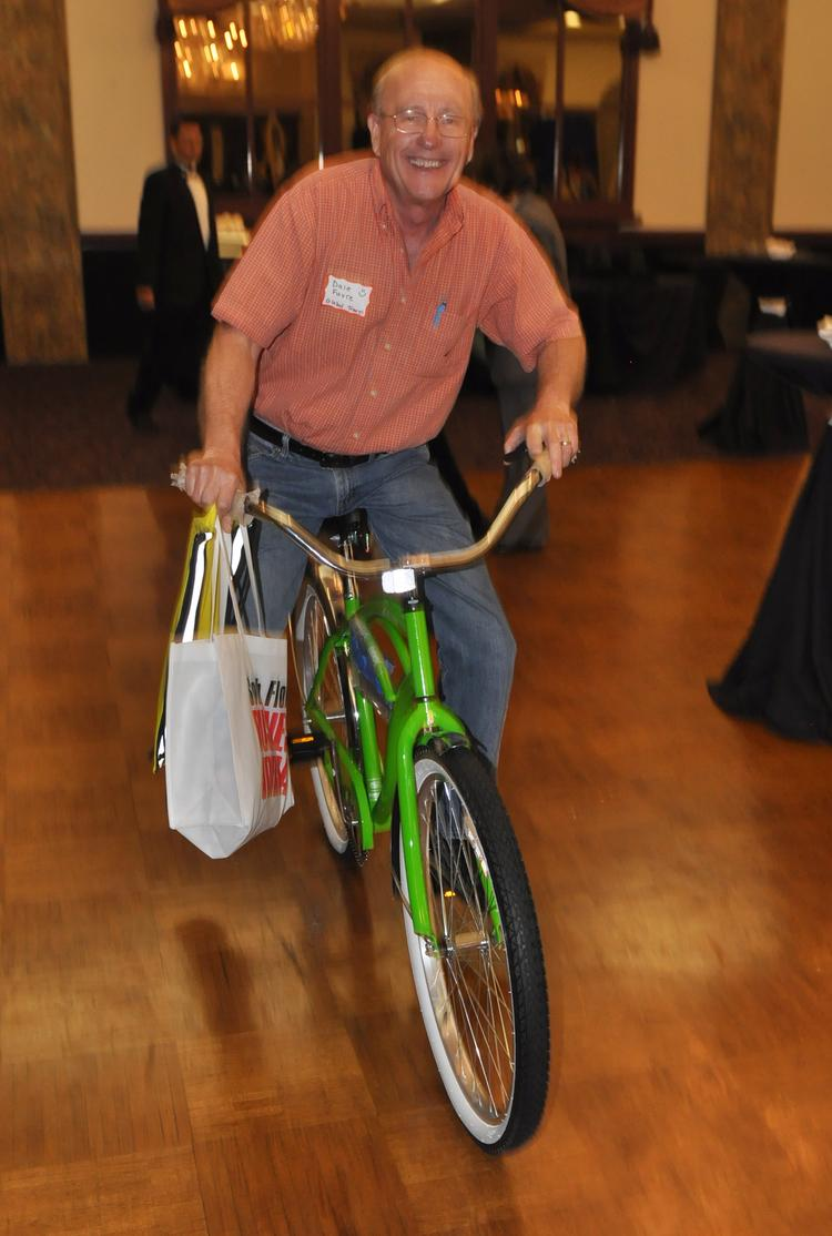 Dale Favre won the bicycle from Regions Bank and is riding it out.