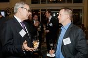 Michael Dell Isola of Bond Brothers converses with Brookstone's Jim Speltz at the Boston Business Journal's Power 50 event at the Boston Harbor Hotel.