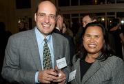 Ernst & Young's Sal Vaudo with First Eastern Mortgage's Mealea Chan-Polcari at the Boston Business Journal's Power 50 event at the Boston Harbor Hotel.