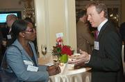 Chandra Briggman of the U.S. Postal Service and Matt Johnson of RCG Global Services converse at the Boston Business Journal's Power 50 event at the Boston Harbor Hotel.