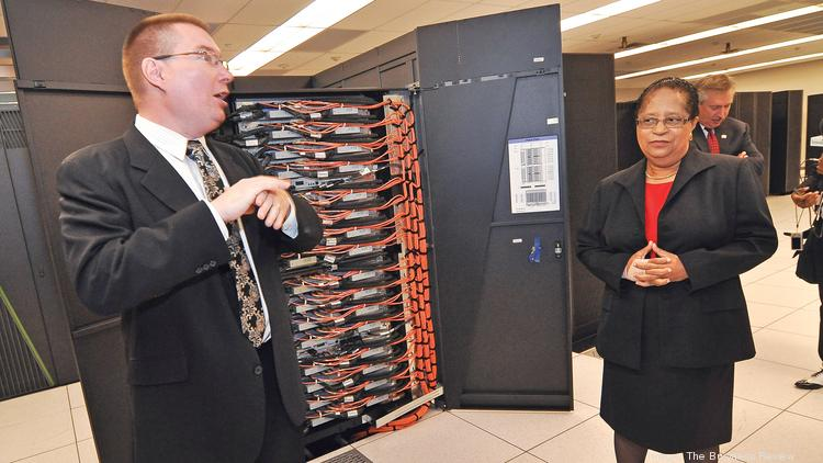 Rensselaer Polytechnic Institute's Center for Computational Innovations Director Christopher Carothers and President Shirley Ann Jackson display the inside of one of IBM's supercomputers.