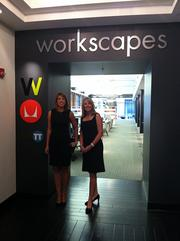 Sarah Bermudez, left, director of sales for Workscapes Inc.'s Jacksonville office, and Elizabeth Dvorak, Workscapes president and CEO, at the entrance to the new showroom.