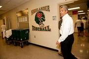 It's not easy choosing green Drive to the Woodlands High School for a booster club meeting, which Coll is president of. The club is picking a shade of green paint for the boys' locker room, which is being updated. The choice? A rich hunter green. Coll and his wife, Sarah, have been active with the club for several years, as all three of their sons have played football at the school.