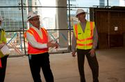 Hardhat tour Coll meets up with John Frere, real estate and facility manager, for a progress tour of Hackett Tower. Hardhats, goggles and neon vests for everyone.