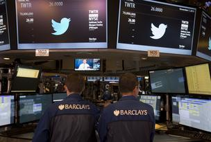 Traders work during Twitter Inc.'s initial public offering (IPO) on the floor of the New York Stock Exchange (NYSE).