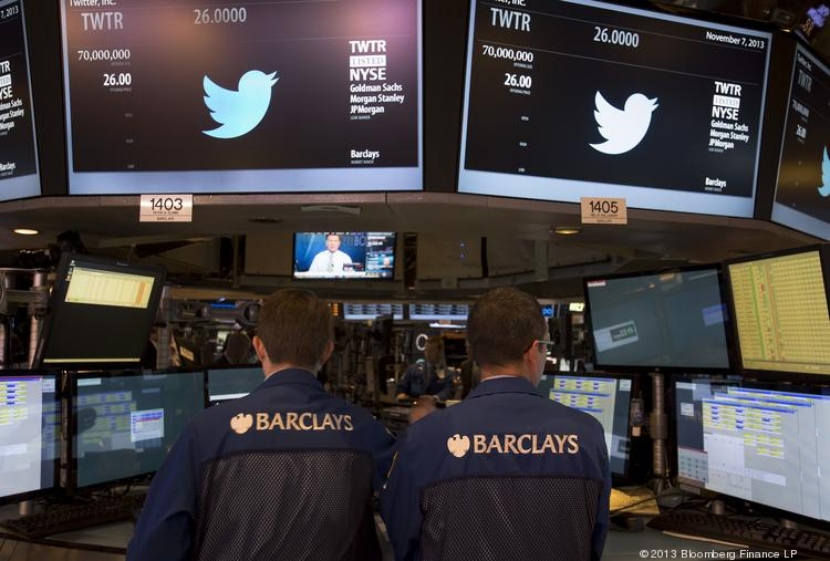 Traders work during Twitter Inc.'s initial public offering on the floor of the New York Stock Exchange in New York on Thursday. Twitter investors paid a premium for its promises of fast growth.