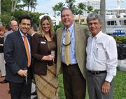 Carlos Molinet and Kelly Tortoriello of the Fort Lauderdale Convention & Visitors Bureau with Bob Swindell of The Greater Fort Lauderdale Alliance and Thomas Miller of Miller Construction Company.
