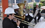 The Symphony of the Americas performs at the topping off ceremony.