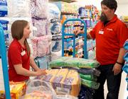 Here, Bloom talks with an assistant manager at a Family Dollar retail store.