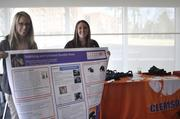Riley Csernica and Chelsea Ex-Lubeskie of Clemson's Tarian Orthotics pose with their display.
