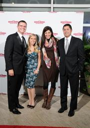 Matt Farrell of The NCAA First Four, and his wife, Kristine, along with Carmen and JP Nauseef on the red carpet at the Dayton Business Journal's Business of the Year event.