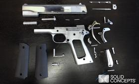 Disassembled parts of the 3-D printed 1911 gun.