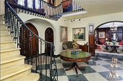 10490 Ladue Road: The entry features custom arched doorways and a terrazzo floor.