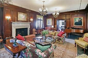 10490 Ladue Road: The formal living room is paneled.