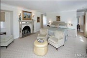 10490 Ladue Road: The master bedroom features a custom fireplace, a renovated bath and heated marble floors.