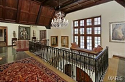 10490 Ladue Road: The wood vaulted ceiling and chandelier.