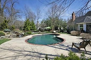 11223 Hunters Pond Road: The backyard features custom landscaping and a pool.