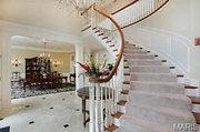 11235 Hunters Pond Road: This home features a marble foyer.